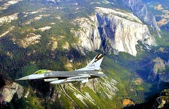 194th Fighter Squadron General Dynamics F-16C Block 25E Fighting Falcon, AF Ser. No. 84-1376, flying over the Sierra Nevada with four AIM-120 missiles on an Operation Noble Eagle mission in 2002