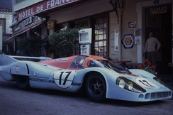 1971 Le Mans Porsche 917LH driven by Derek Bell and Jo Siffert parked outside the Hotel de France