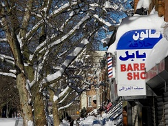 Bay Ridge in Brooklyn, New York City; also has a strongly diverse Arab community, in which its largest Arab groups are Palestinians and Yemenis. Its strong presence is noticeable from Arab shops to Babel Barber Shop, shown above during the January 2016 snow storm.