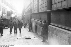 A body lies in the  via Rasella, Rome, during the round up of civilians by Italian collaborationist soldiers and German troops after the partisan bombing on 13 March 1944.