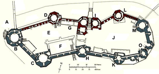 Plan of Caernarfon Castle: A – Site of Water Gate; B – Eagle Tower; C – Queen's Tower; D – Well Tower; E – Lower Ward; F – Great Hall; G – Kitchens; H – Chamberlain Tower; I – King's Gate; J – Upper Ward; K – Black Tower; L – Granary Tower; M – North-East Tower; N – Cistern Tower; O – Queen's Gate. Blue shows the area built between 1283–92, red that between 1295–1323