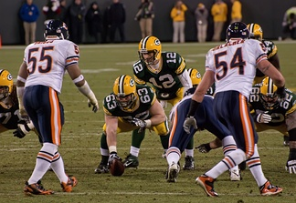 In white jerseys, Lance Briggs (55) and Brian Urlacher (54) of the Chicago Bears, are positioned as linebackers on Lambeau Field in 2011