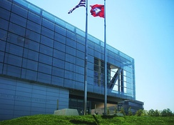 The glass screen, which acts as a sunscreen, is on the main building's western face.