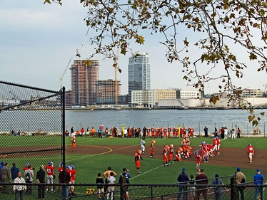 The East River passes children playing football in East River Park (2008)