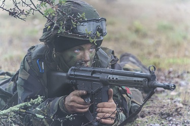 A female soldier of the Portuguese Armed Forces in position, with her Hecker and Koch G3 Rifle, during a field exercise