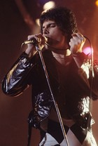 Freddie Mercury performing