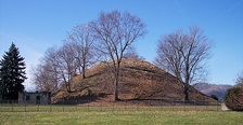 Grave Creek Mound, located in Moundsville, West Virginia, is one of the largest conical mounds in the United States. It was built by the Adena culture.