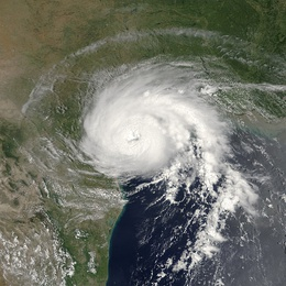 View of the storm from Space on July 15, 2003. The roughly circular storm is about to make landfall in Texas. Mexico and Louisiana are seen to the south and north, respectively.