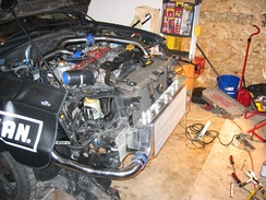 Fitting an after market front-mounted intercooler to a car with a factory-installed top-mounted one