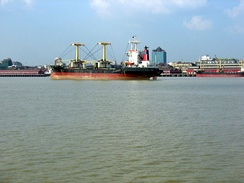 Cargo ships on the shores of Yangon River, just offshore of Downtown Yangon.