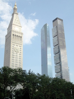 The Met Life Tower, with its landmark clock, and the residential skyscrapers Madison Square Park Tower, expected to open in 2018, and One Madison, which opened in 2013, rise over Madison Square Park.