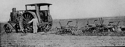 An Avery tractor pulling three sod cutters on a farm near Larned, Kansas around 1916.