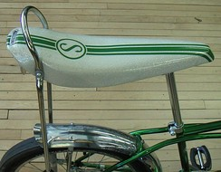 Schwinn banana seat with sissy bar, bobbed fender, and slick, square-profile tire