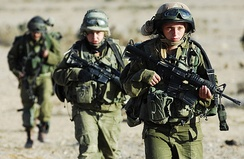 Three armed female soldiers