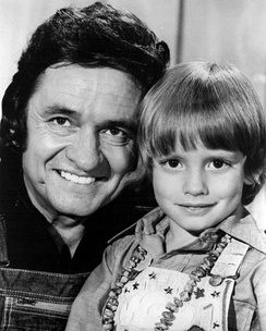 A young Carter Cash with Johnny Cash in 1975