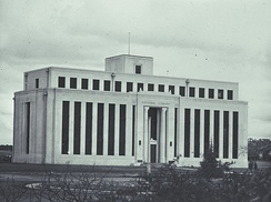 The original National Library building on Kings Avenue, Canberra, was designed by Edward Henderson. Originally intended to be several wings, only one wing was completed and was demolished in 1968. Now the site of the Edmund Barton Building.