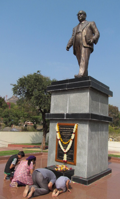 People paying tribute at the statue of Babasaheb Ambedkar.