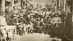 Rebetes in Karaiskaki, Piraeus (1933). Left Markos Vamvakaris with bouzouki.