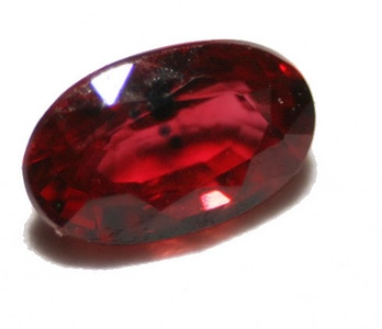 Ruby is the color of a cut and polished ruby gemstone.