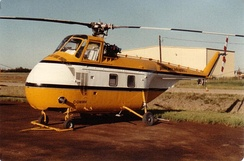A Sikorsky S-55B in service with Golden West Helicopters, St. Albert, Alberta, 1985. Fairings for transmission and tail rotor driveshaft have been removed; note later-style downward-inclined tailboom.
