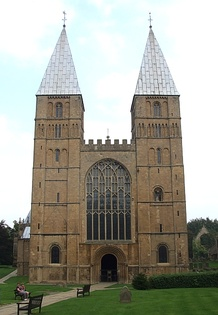 Southwell Cathedral, England, 1120, follows the Norman model with pyramidal spires as were probably at Saint-Étienne. The Perpendicular window and battlement are late Gothic.
