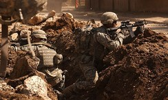 U.S. soldiers take cover during a firefight with insurgents in the Al Doura section of Baghdad 7 March 2007.