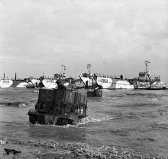 Universal Carrier of 50th Division wades ashore D-Day 6 June 1944.