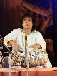 Ustad Zakir Hussain performing at Konark, Odisha.  This illustrates the common sitting position used by tabla players.