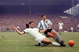 Wolfgang Weber (left) and Luis Artime during the match between West Germany and Argentina in Birmingham