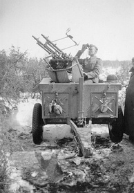 German soldier manning a MG34 anti-aircraft gun in WW2