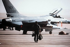 A New York Air National Guard F-16 pilot from the 174th Tactical Fighter Wing, 138th Tactical Fighter Squadron, prepares to take-off on a combat mission from a Saudi Arabian base, Operation Desert Storm, 1991