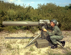 A U.S. Army soldier in 1964, with the first concept mock-up of Redstone Arsenal's proposed future HAW system (Heavy Antitank Weapon). The HAW ultimately resulted in the modern-day TOW.