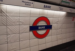 London Underground roundel (flanked by City dragons) at Bank station.