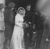 Photograph of screenwriter William Rose on his wedding day in 1944, along with his wife and guests.