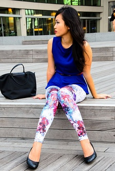 A woman wearing white leggings with a floral design