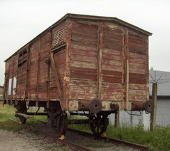 A cattle truck used for the transport of Belgian Jews to camps in Eastern Europe. The openings were covered in barbed wire.[41] This example is preserved at Fort Breendonk.