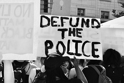 "Marchers holding ""Defund The Police"" during George Floyd protests, June 5, 2020"