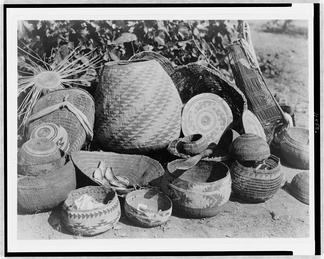 An assembled collection of Karuk made baskets. These were quite popular among the Shasta and frequently purchased.
