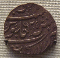 The French East India Company issued rupees in the name of Muhammad Shah (1719–1748) for Northern India trade.  This was cast in Pondicherry.