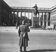 German sentries before the Saxon Palace (Polish General Staff building) where the German military Enigma had been broken and read by the Poles for several years before the war.  Photo taken before 30 August 1940, when the Germans concealed Thorvaldsen's statue of Prince Józef Poniatowski.
