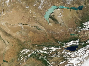 Portions of Kazakhstan (top) and Kyrgyzstan at the bottom. The lake at the top of the image is Lake Balkhash.