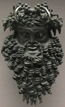 Bronze mask depicting Dionysus bearded and horned, 200 BC - 100 AD. Height 21.4 cm.[150]