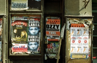 Ozzfest concert poster on an empty storefront door in downtown Prague, Czech Republic (Summer 2002).