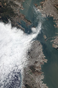 Fog enters San Francisco Bay through the Golden Gate, seen here in August 2012