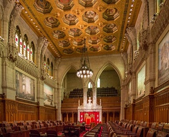 Chambers of the Senate of Canada in Centre Block. Women were made eligible for the Senate after a petition from the Famous Five resulted in a court decision that concluded the term persons encompassed women.