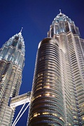 Petronas Twin Towers in Kuala Lumpur, Malaysia, are 88-floor towers constructed largely of reinforced concrete, with a steel and glass facade designed to resemble motifs found in Islamic art, a reflection of Malaysia's Muslim religion.[96]