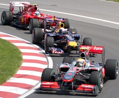 Lewis Hamilton leading Sebastian Vettel and Fernando Alonso at the Canadian Grand Prix. Hamilton won the race to take the Drivers' Championship lead.