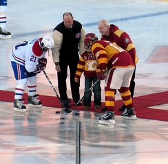 Hall of Famers Bob Gainey and Lanny McDonald perform the ceremonial faceoff.