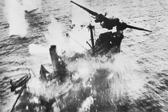 U.S. A-20 Havoc of the 89th Squadron, 3rd Attack Group, at the moment it clears a Japanese merchant ship following a successful skip bombing attack. Wewak, New Guinea, March 1944