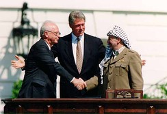 Yitzhak Rabin, Bill Clinton, and Yasser Arafat at the Oslo Accords signing ceremony on 13 September 1993